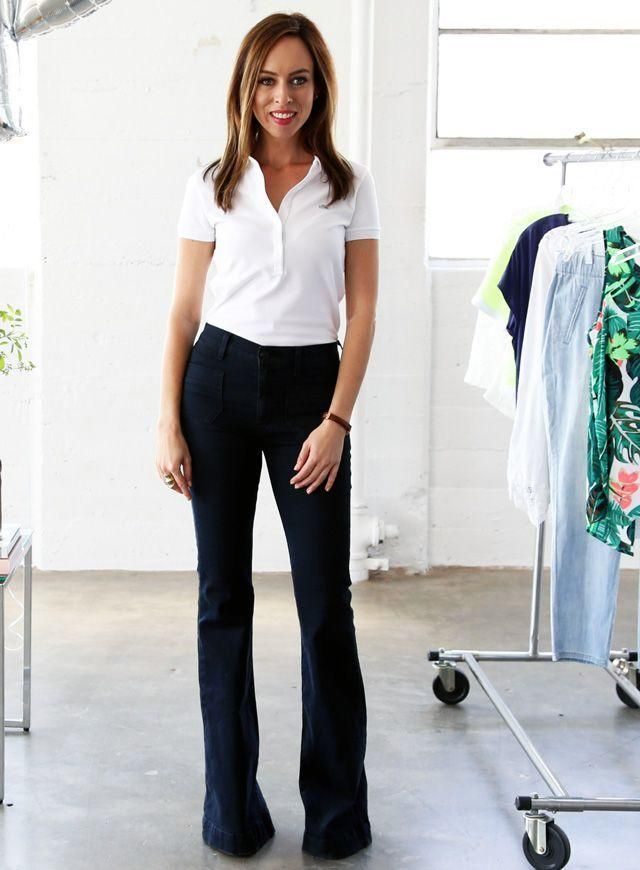 Take advantage of the season's biggest trend, and tuck a crisp polo shirt into a pair of flared jeans as Sydne Style did here. The '70s staple helps tone down the preppy feel of collared shirts. Finish the look with chunky sandals.