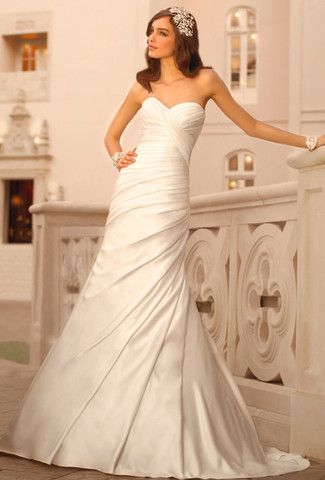 This ivory Stella York A- line wedding dress is made from rich regal satin and features asymmetrical ruching along the soft sweetheart bodice and throughout the hips. The fun and flirty skirt falls in                                                                                                                                                      More
