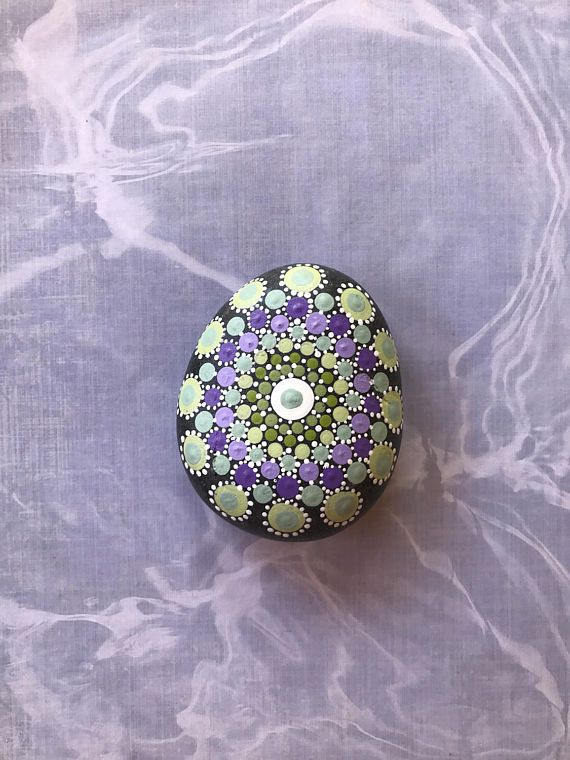 Dot painted mandala rock in shades of lavenderblue grey and