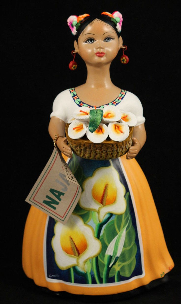"""- """"Lupita"""" with Basket of Calla Lilies, Mexican Ceramic Figurine with a Yellow Dress. - The figurine is 11-3/8"""" tall and 6 1/4"""" wide at the base. - Please note all details. This figurine has the Dress"""