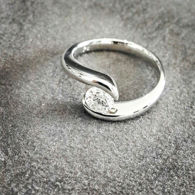 """AFRICN - DIAMONDS  - PLATINUM  This stunning """"Tension"""" ring has a perfectly polished 0.51ct diamond wrapped in handcrafted platinum.  #africndiamonds #africn #diamonds #platinum"""