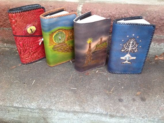 Hand tooled leather LOTR and Hobbit covers (The door on the hobbit hole opens!)