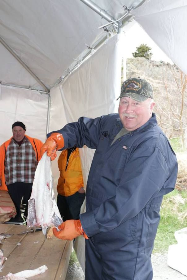 Local fisherman Dave Parsons showing the participants the traditional way to split a cod for salting, he also broke down the cod afterwards ...