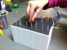 Styrofoam, toothpicks, and beads... I've done this with cheerios too.
