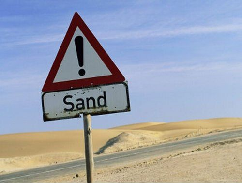 Caution - Sand!  Road sign warning of sand, Swamopmund, Namibia, Africa