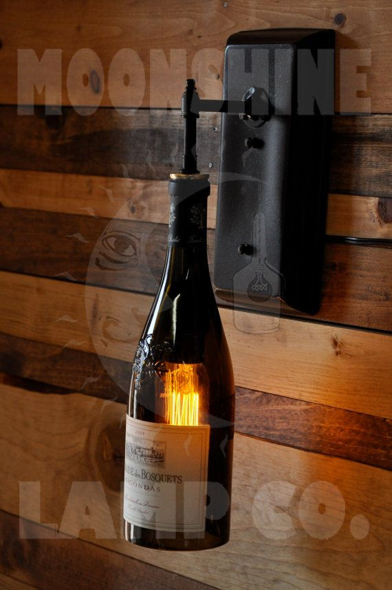 This is a wall sconce made from YOUR favorite wine or liquor bottle. The wall plate and tubing is all brass. Choose a finish of oil rubbed bronze, gloss black or flat black. Included is a 30 watt vintage style lightbulb. Darker bottles do cut down the light, so if you have a bottle thats a lighter color, it would be preferable. Or, if you want to put a compact fluorescent bulb in the unit, youll get a lot more light and the glass will remain cool. If you dont have a power source in your…