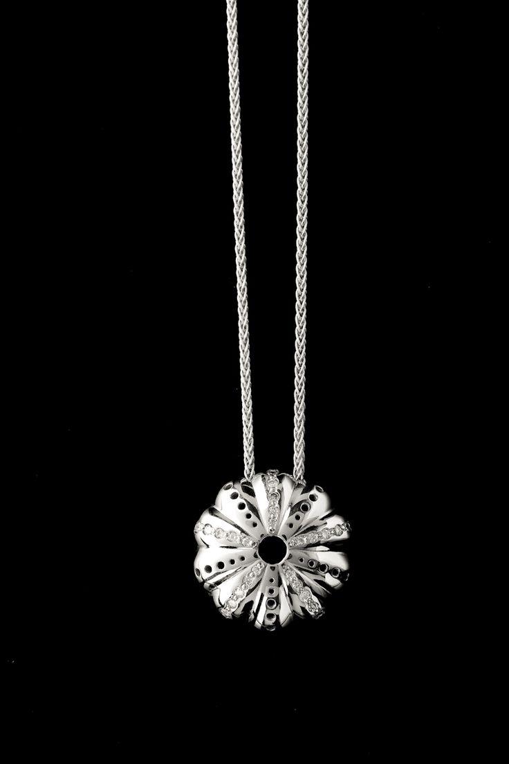 18ct white gold Baby Kina pendant enhanced with diamonds.