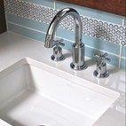 kitchen sink with blue backsplash tile medley.