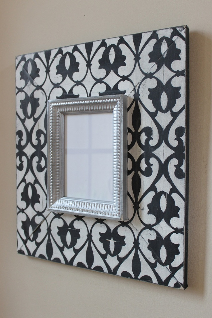 Imperial Wood Distressed Picture Frame 8x10 Hand painted, Black and Vintage White. $80.00, via Etsy.