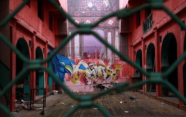 Graffiti is seen in a shuttered shopping arcade in central Athens. (© AP Photo: Dimitri Messinis)