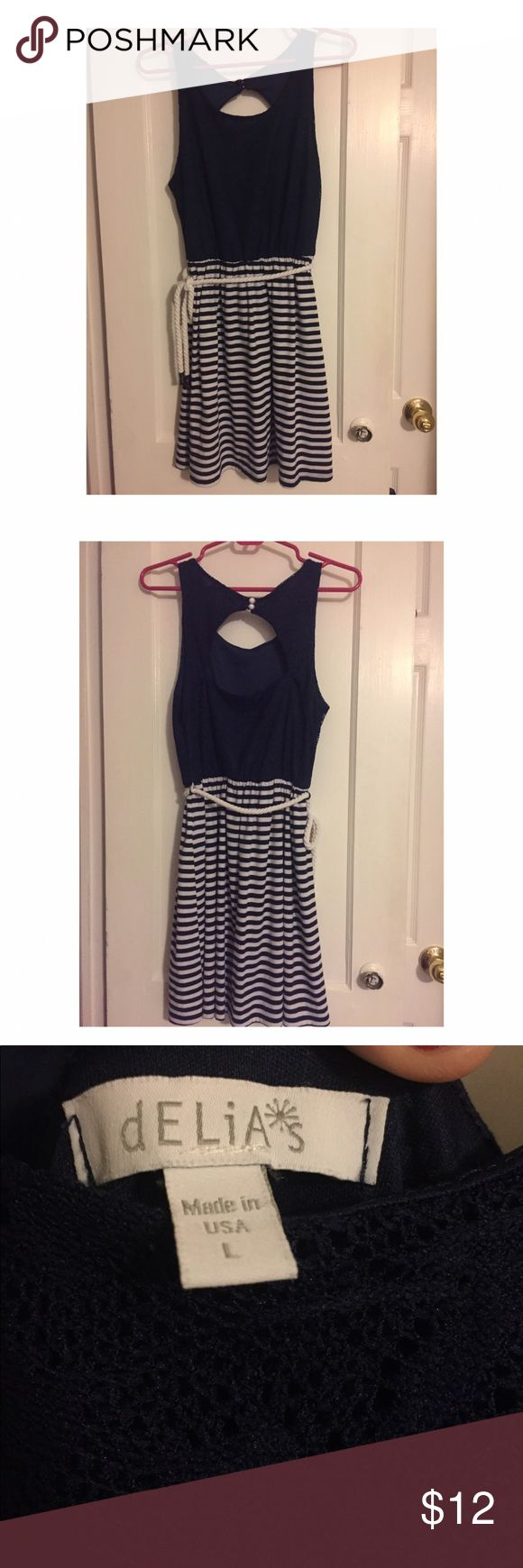 Nautical Summer Dress The perfect dress for beach & boat parties! ⚓️⚓️⚓️⚓️⚓️⚓️⚓️⚓️⚓️⚓️⚓️⚓️⚓️⚓️⚓️⚓️⚓️ Size: Large Colors: Navy Blue & White Condition: lightly worn, no tears or issues * Machine Washable * Comes with rope tie around waist Delia's Dresses Mini