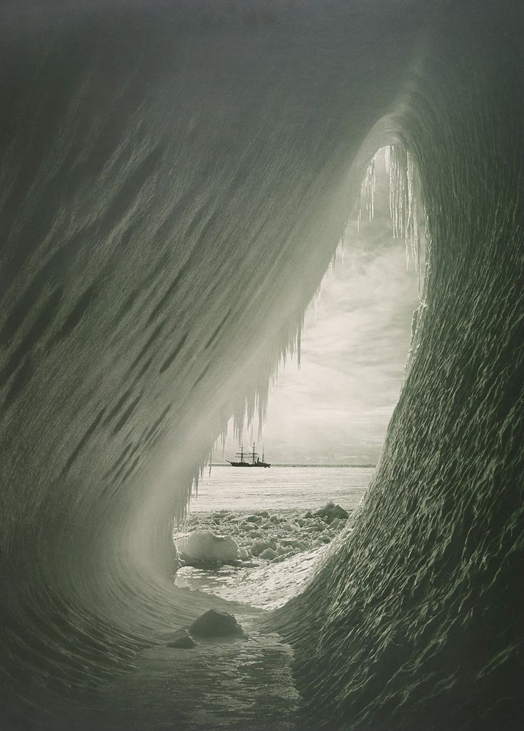 Captains Scott's ship viewed from an ice cave.