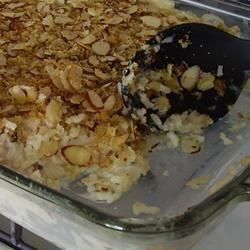 Something of a chicken salad casserole, with rice, almonds, celery, and water chestnuts in a mayonnaise dressing. The almond and corn flake topping provides additional crunch. Bake ahead, as this freezes well.
