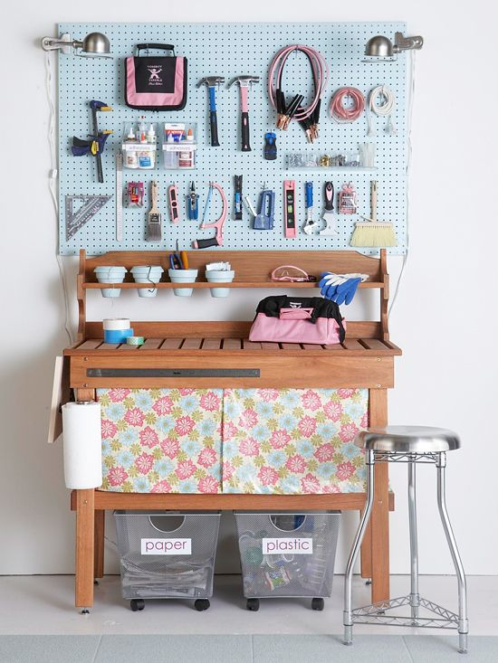 A traditional potting bench provides a large surface area for working, while a pegboard keeps tools within reach