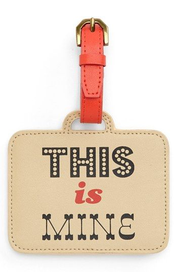 The luggage tag that says hands off