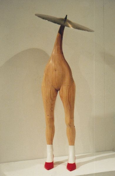 Cymbal with legs sculpture by John Abery. Musical instrument wood sculptures series.