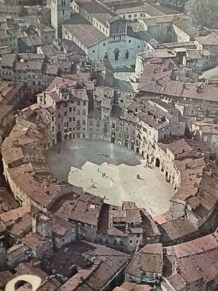 Piazza dell' Anfiteatro, on the footprint of the ancient Roman amphitheater, Lucca, Tuscany, Italy