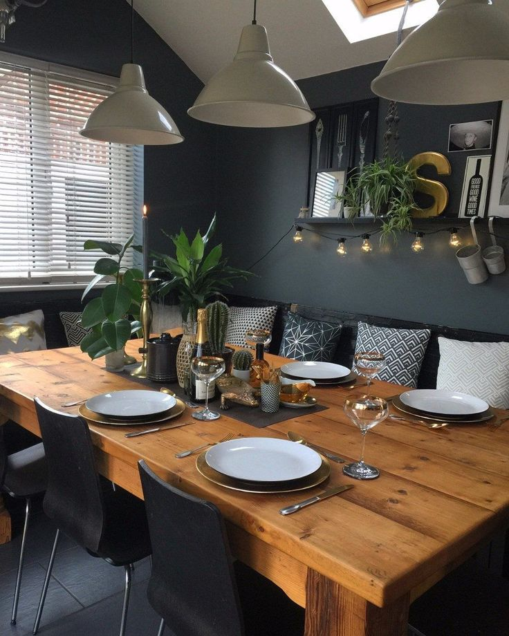 Like The Dark Dramatic Paint Colour In This Dining Room With Wood Table And Oendants