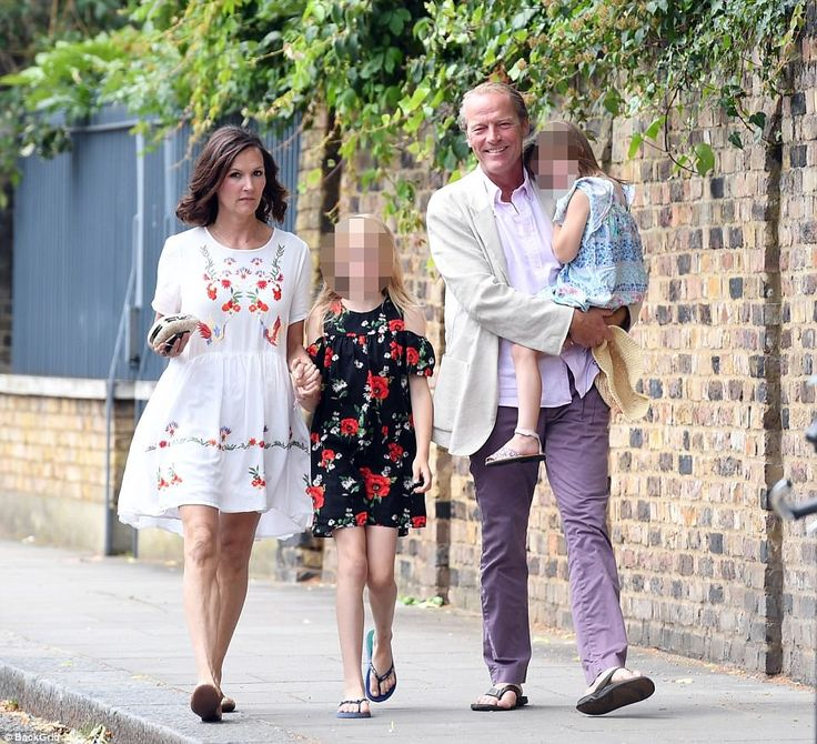 Game of Thrones actor Iain Glen arrives with his partner Charlotte Emmerson and his two da...