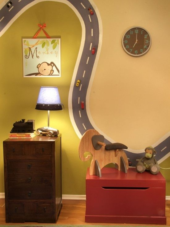 Paint the road with magnetic paint and add magnets to the cars. That is perfect for the play room!