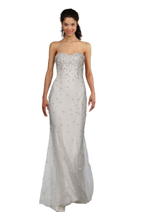 """Brides.com: Wedding Dresses for Petite Figures. Tip: Show Off a Slim Waistline with a Sheath. A sheath wedding dress leaves little to the imagination. The slim, close-fitting shape clings to the body thus creating a clean, continuous line.  """"Marguerite"""" tulle wedding dress with pearl and crystal hand beading, Christos"""