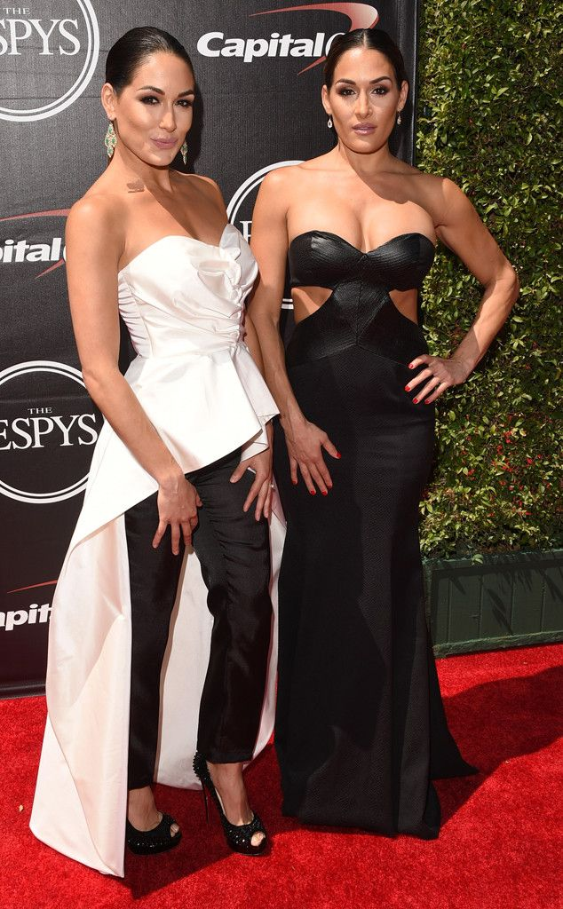 Nikki & Brie Bella from 2015 ESPY Awards Red Carpet Arrivals  With coordinating monochromatic looks, the Total Divas stars opt for bold ensembles.