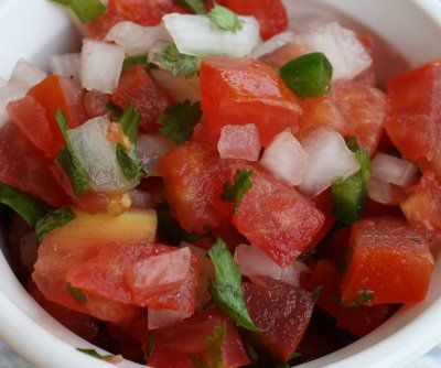 Pico de Gallo      5 plum tomatoes  1/2 large or small red onion  3 jalapenos (optional)  cilantro  lime juice  salt  Quantities are approximate    Chop jalapenos, onion, and tomatoes in a very small dice. Leave seeds in your jalapenos for a hotter pico. Adjust the amount of jalapenos for your preferred temperature. Next, chop up a nice-sized bunch of cilantro. Disregard the long stems before chopping. Stir together. Add the juice of a half a lime and add salt to taste.