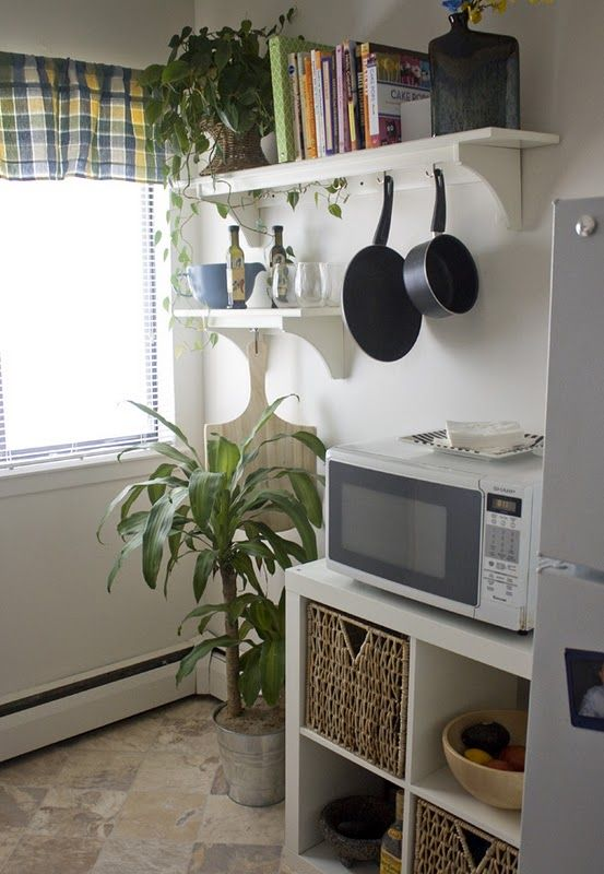 love that microwave stand with storage bins, and the hanging skillet and pot holders