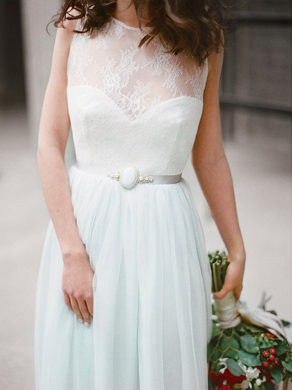 This gown features a sweetheart neckline, matte satin bodice with Chantilly lace overlay, and fabulous key hole open back. The skirt is made using