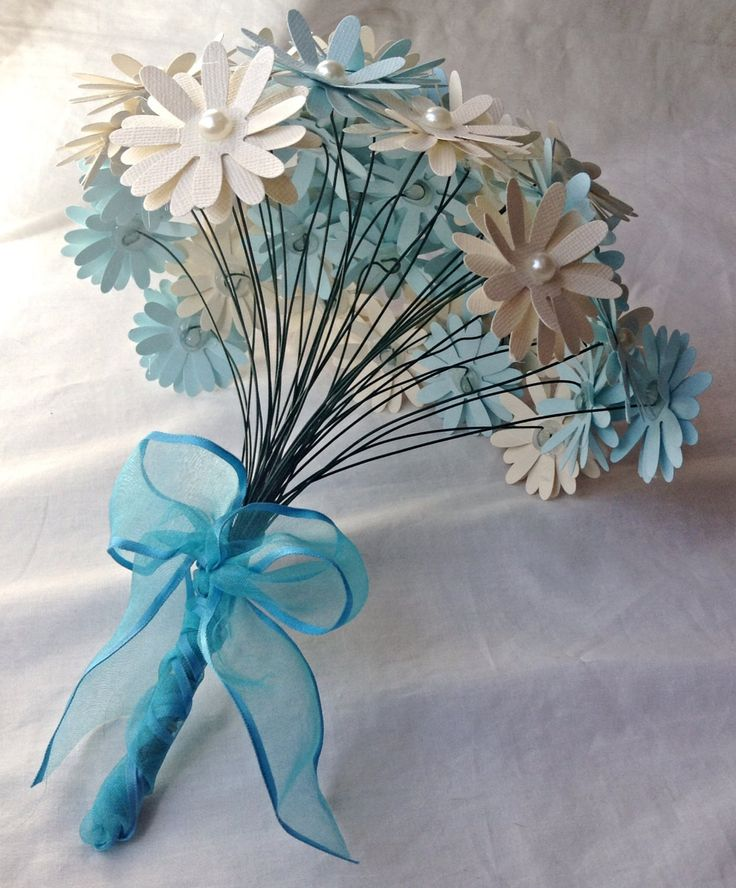 These adorable paper daisies are perfect for any occasion. They are made from layers premium card stock. Each flower is appox. 2.5 inches, has pearl center, and is mounted on a wire stem. They can eas