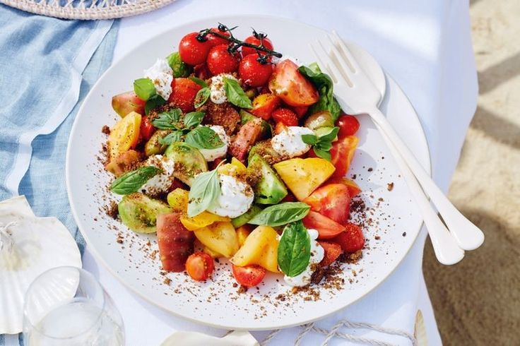 Craig Knudsen's vibrant heirloom tomato salad is given a twist with rye bread crumbs and yoghurt.