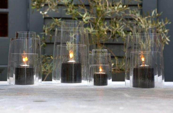 Glass hurricane lanterns ; Gardenista