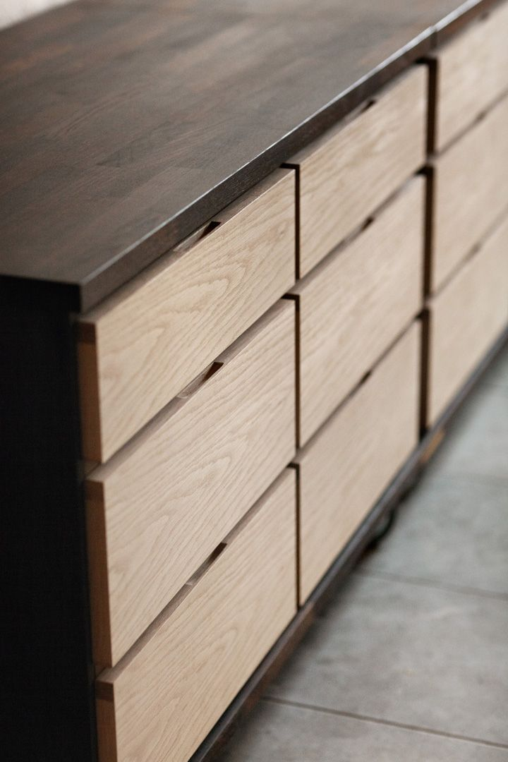 Concealed hand slots on drawers, creating a very minimal and a clean look. Also, the color combination is just beautiful.