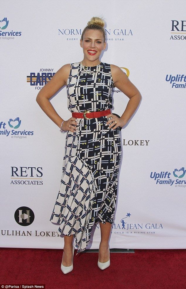 Red carpet: Actress Busy Philipps looked stylish in a geometric-print dress at the Norma J...