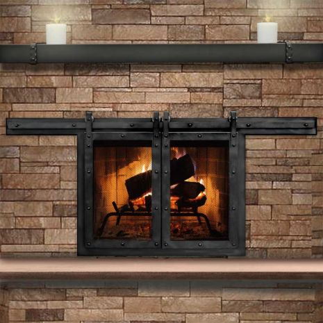 Rustic fireplace door. Matches the sliding interior barn doors!