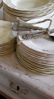 antique silver and white dinnerware