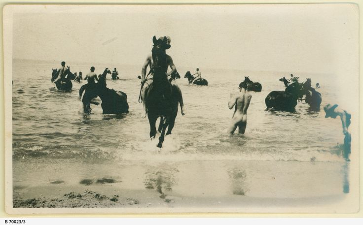 Men and horses of the 9th Light Horse Brigade taking time out in the sea, during service in the Middle East