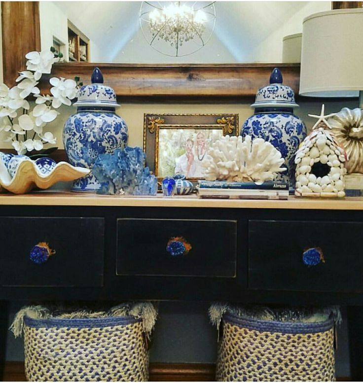 Blue and white ginger jars with blue and white coral vignette.