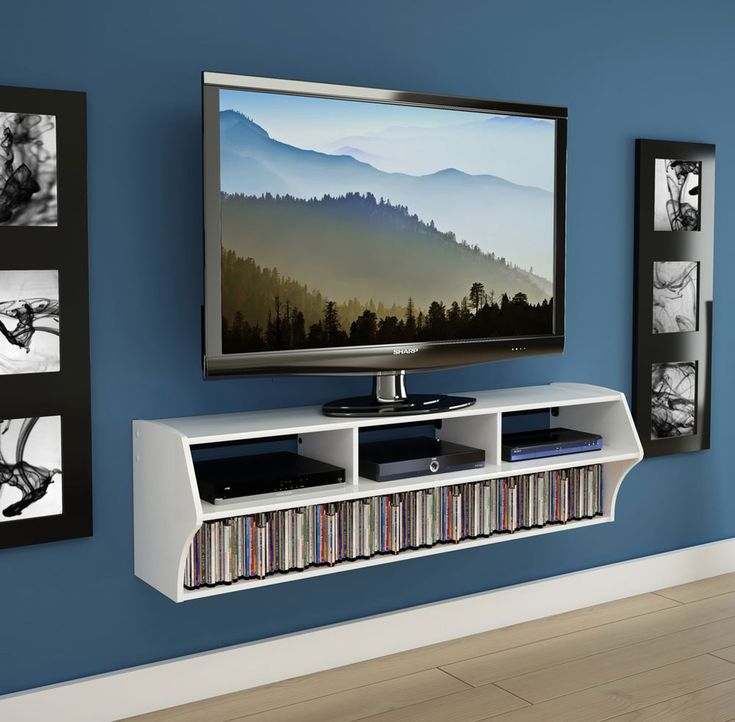 TV Shelf // Media Shelf // Display your TV at any height in your modern living area using this Wall Mounted White TV Console. Designed using a patented hanging rail system, this wall-mount console is easy to hang at any height using the included hardware. A generous 165-pound weight capacity means you can easily display flat screen televisions up to 58 inches.