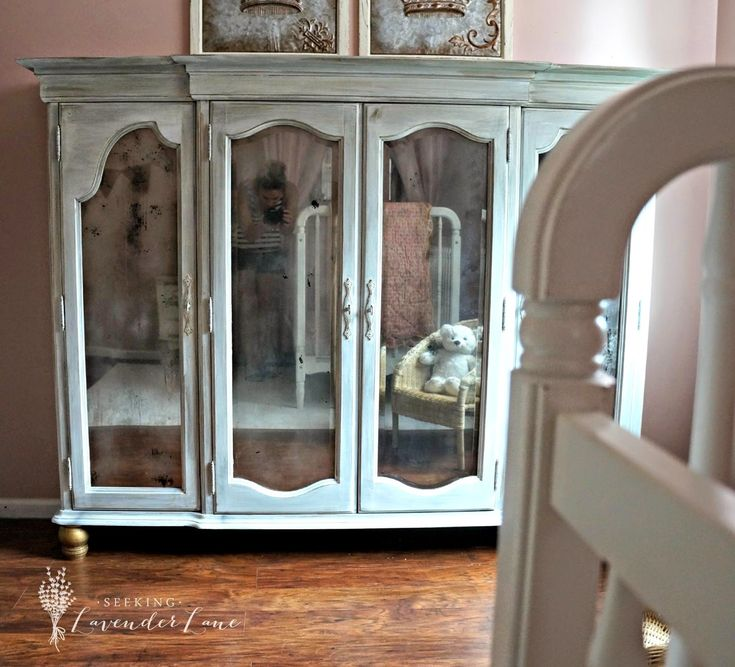 Just the top of a hutch as a cabinet, added feet and painted glass with mirror spray paint.