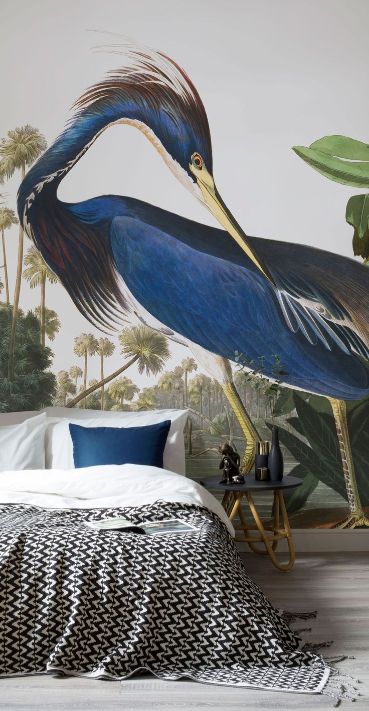 Bring an air of sophistication to your interiors with this classic Birds of America wallpaper. Revel in the royal blue hues and transform your bedroom spaces in an instant.