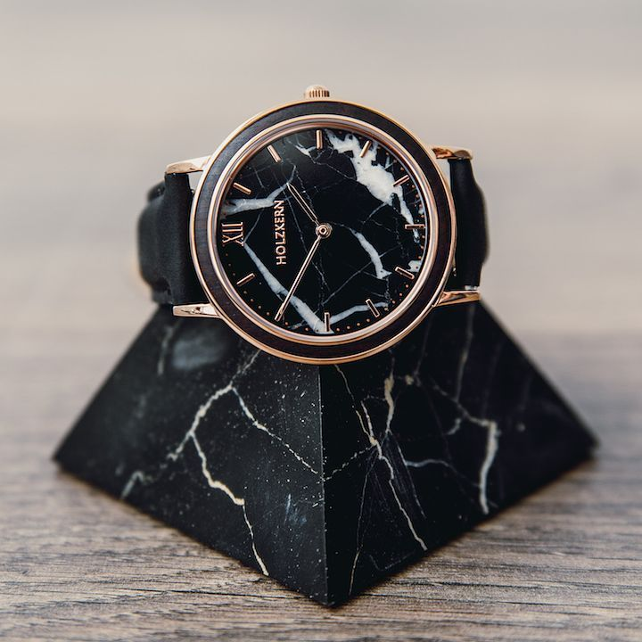 Black marble never gets out of style!  . . Have a look on www.holzkern.com  and find more unique timepieces made of this classy material! . .  @lukasleertaste