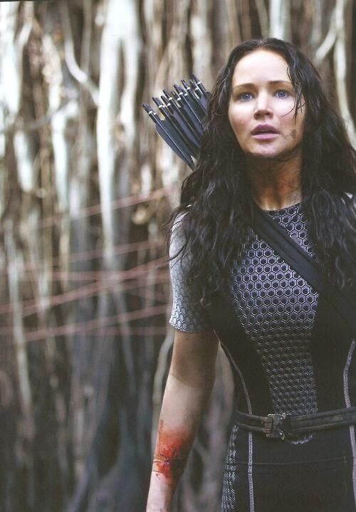 Katniss Everdeen still from Catching Fire. Look! You can see where Johanna dug out Katniss's tracker!!!! Excited!!