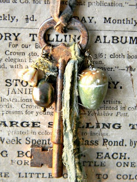❥ woodland cottage key - the necklace is made of a vintage key, which i have turned in to a antique gold with a gilders paste. one of my handmade air dry clay acorn, which i have painted and then protected with a varnish. lovely ragged ribbon. moss green mother of pearl bead. picasso flower bead. tiny bit of hand dyed lace. soft moss green velvet ribbon.