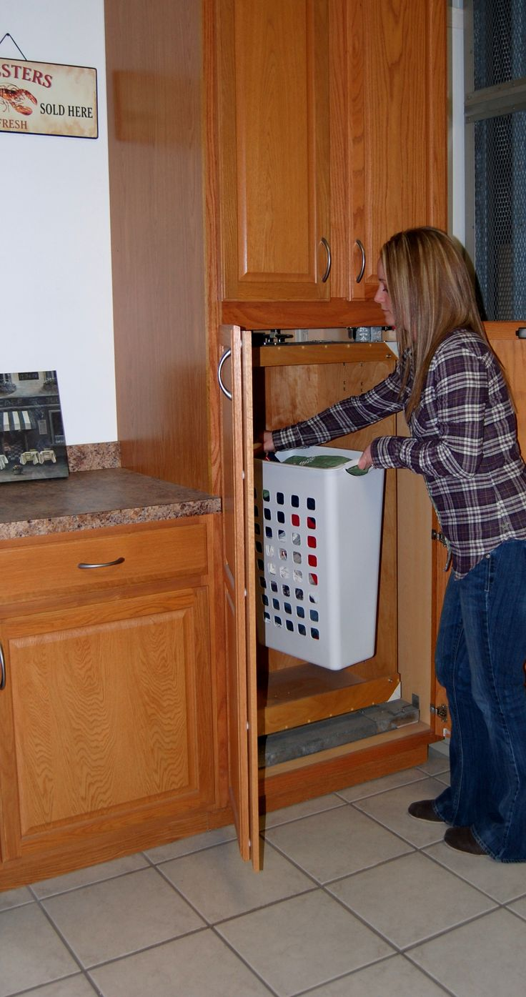 simple dumbwaiter | Photo of woman using dumbwaiter.