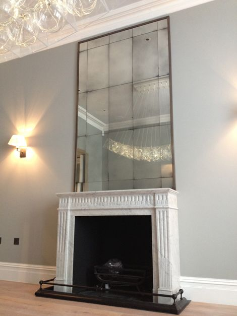 Rupert bevan antiqued glass mirror over mantle