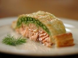 Salmon en Croute | | Recipe courtesy Laura Calder | Show: French Food at Home | Episode: The Puff Pastry Show |    It looks and sounds fancy, but all you need to make Laura Calder's en croute recipe is a salmon fillet, asparagus spears, creme fraiche and some store-bought puff pastry. Go ahead, though, and let your valentine ooh and aah.  | From: thecookingchanneltv.com