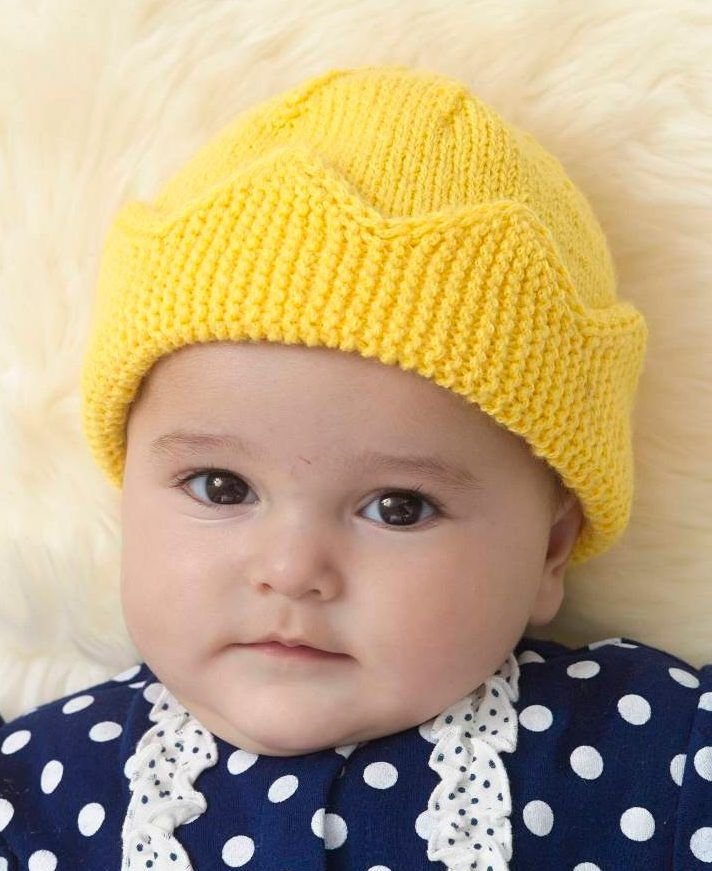 Free Knitting Pattern for Baby Crown Hat - This fun hat by Linda Cyr comes in two sizes. The crown brim is knit flat and the stitches are picked up for the rest of the hat.