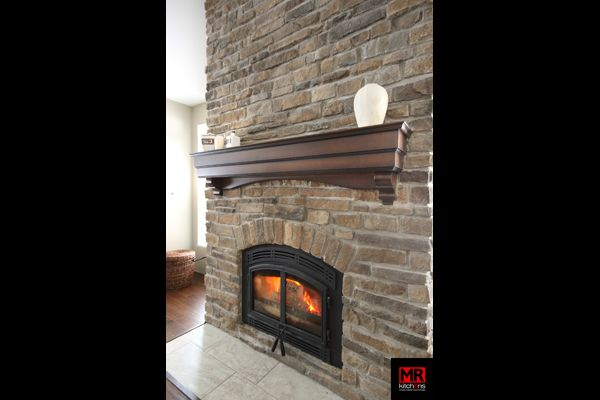 Fireplace mantle.  www.mrkitchens.ca