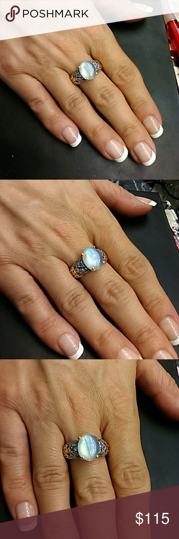 6.50ctw Moonstone & Tanzanite 14k Gold / 925 Stunning artisan Moonstone & Tanzanite ring. Genuine natural 6.50 carat total weight Moonstone & Tanzainte. 14k gold & Platinum over solid 925 sterling silver. Size 10 Can be sized by a jeweler I verified by mine. estate 925 Jewelry Rings
